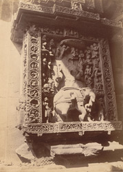 Niche with statue of Indra (damaged) on the façade of the sanctuary of the Rajalinga Temple, Bhubaneshwar